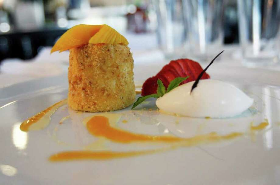 The Sandbar serves a tasty Tahitian vanilla cheesecake with walnut brittle crust. Photo: OMAR PEREZ, San Antonio Express-News / SAN ANTONIO EXPRESS-NEWS