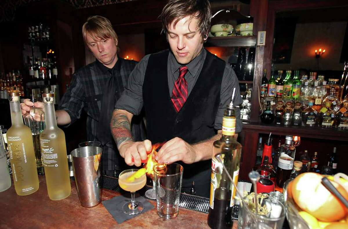 Cedar Social bartenders Craig Reeves (left) and Sonny Bonasera from Dallas prepare cocktails from a special menu during a guest apperarance last weekend at the Esquire.