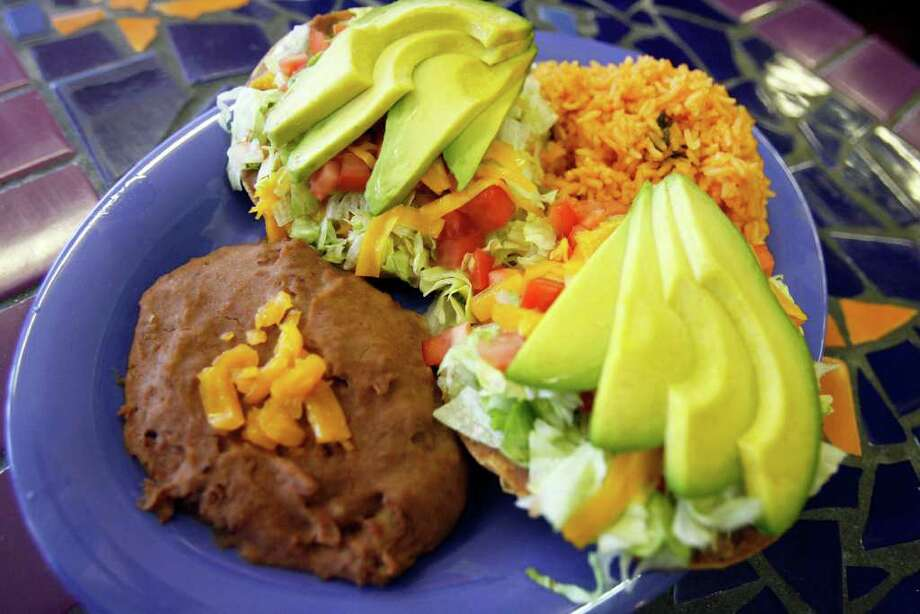 The Chalupa Plate is among the well-made Tex-Mex standards at the Original Donut Shop. Photo: OMAR PEREZ, San Antonio Express-News / SAN ANTONIO EXPRESS-NEWS