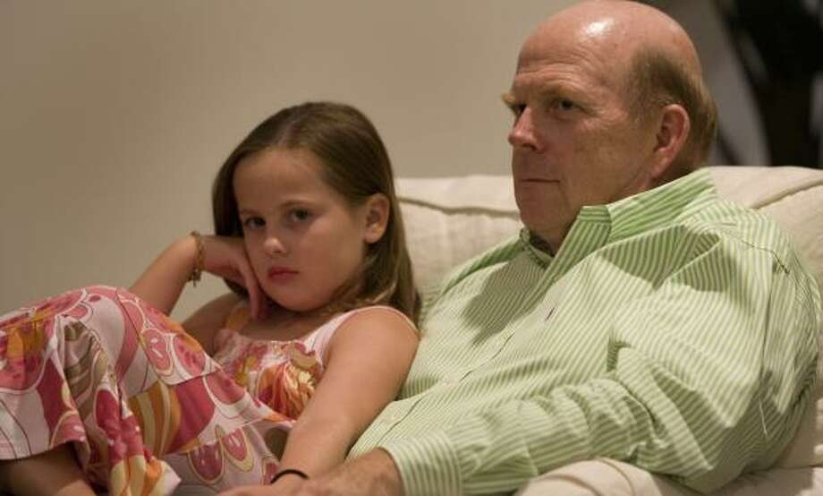 Mike Boyd and his granddaughter, Kaylee, watch a private concert by Mercury Baroque in Boyd's living room. Photo: BRETT COOMER, CHRONICLE