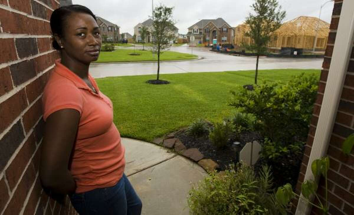 About 60 houses in a new Spring subdivision, including those across the street from Tracy Martin's, would have to be demolished if a four-lane tollway is built as planned.