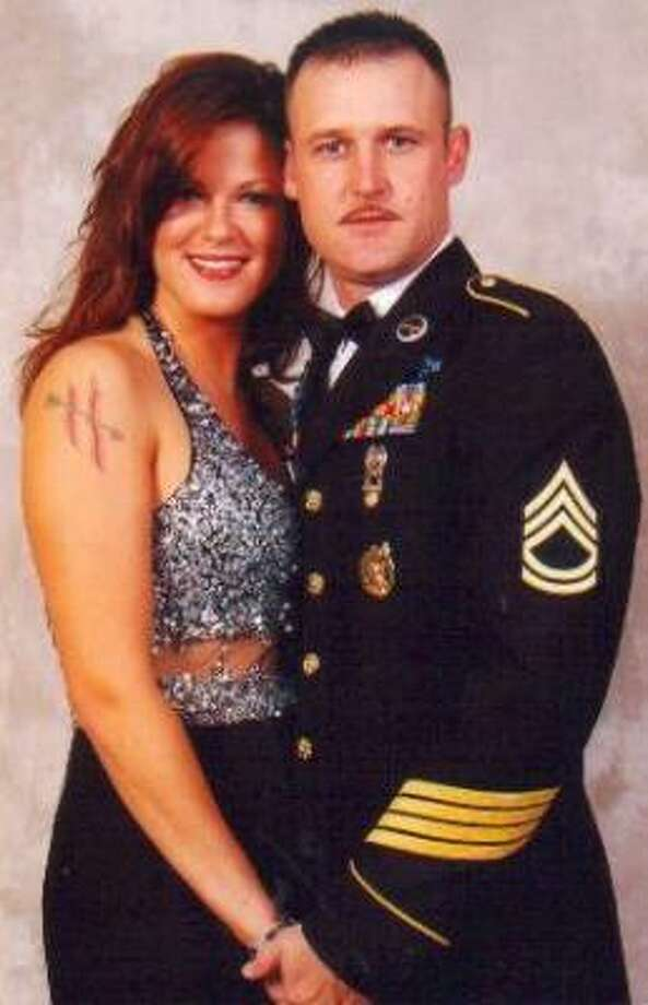 Sgt. First Class Patrick Henderson and his wife, Staff Sgt. Amanda Henderson, were both Army recruiters. Photo: AMANDA HENDERSON, Handout Photo