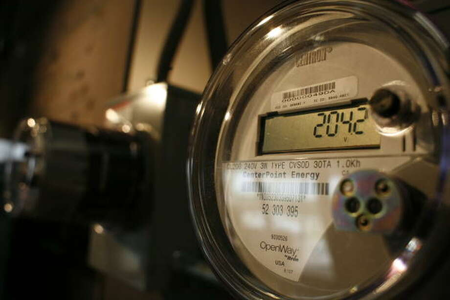 "CenterPoint Energy hopes to begin installing hundreds of thousands of digital ""smart meters"" like this one throughout the Houston area beginning in March. Photo: Steve Ueckert, Chronicle File"