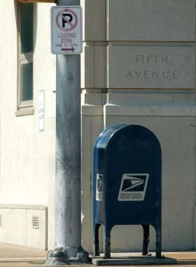 The Postal Service has tried to cut costs by pulling the familiar blue mailboxes from street corners nationwide. Photo: MICHELLE WILLIAMS, BIRMINGHAM NEWS