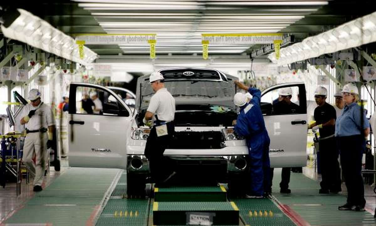 A Toyota Tundra truck is inspected during the final stages of assembly at San Antonio's plant. Toyota said Thursday it will suspend production of the Tundra for three months.