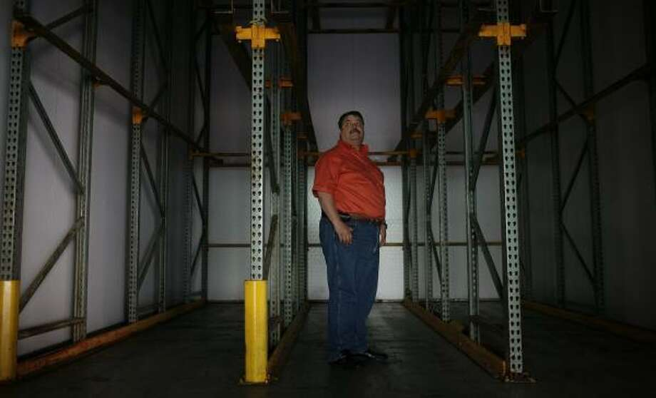 Abraham Dajlala of GR Produce stands in a cooler Friday at his warehouse in McAllen that would normally store three loads of jalapeños from Mexico, three levels high. Photo: LISA KRANTZ, SAN ANTONIO EXPRESS-NEWS