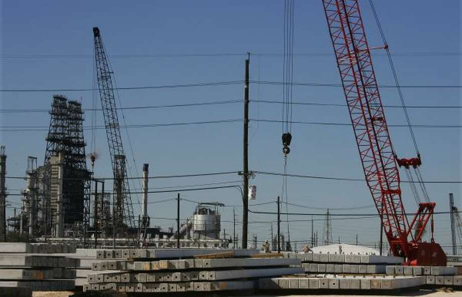 Pilings are driven into the ground for the $7 billion expansion of the Motiva refinery in Port Arthur, one of the large-scale energy projects pumping life into the Beaumont-Port Arthur area's economy. Photo: STEVE UECKERT PHOTOS, CHRONICLE