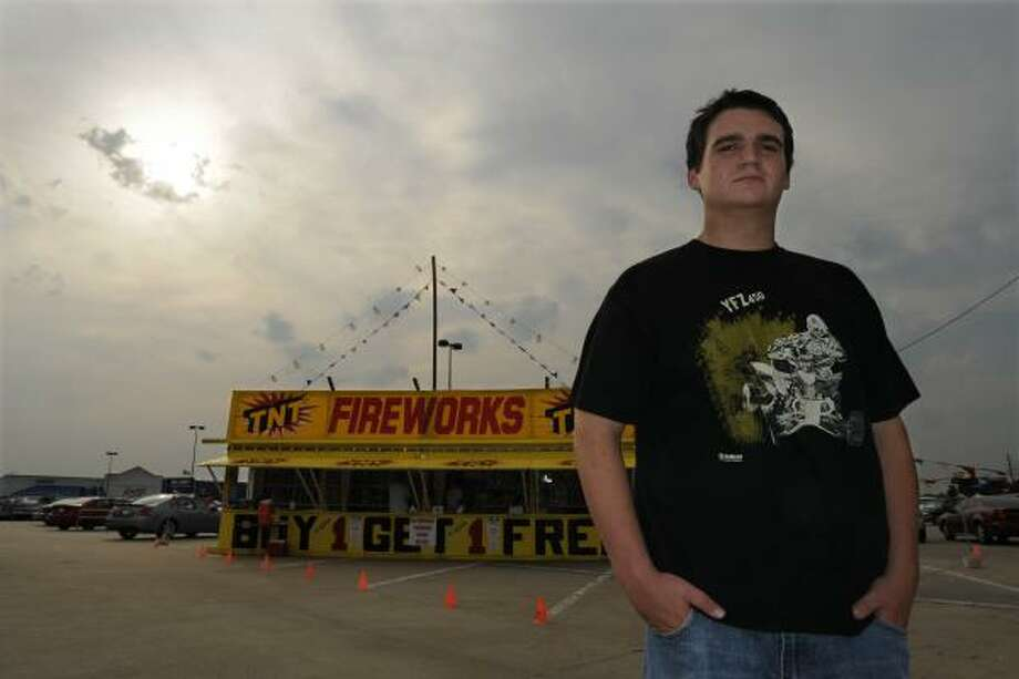 Stephen Gegenheimer, 17, near the stand on Fry Road where he legally purchased fireworks, testified Tuesday for TNT Fireworks in its lawsuit against Houston. The judge denied TNT's restraining order request, but admonished the city. Photo: STEVE UECKERT, CHRONICLE