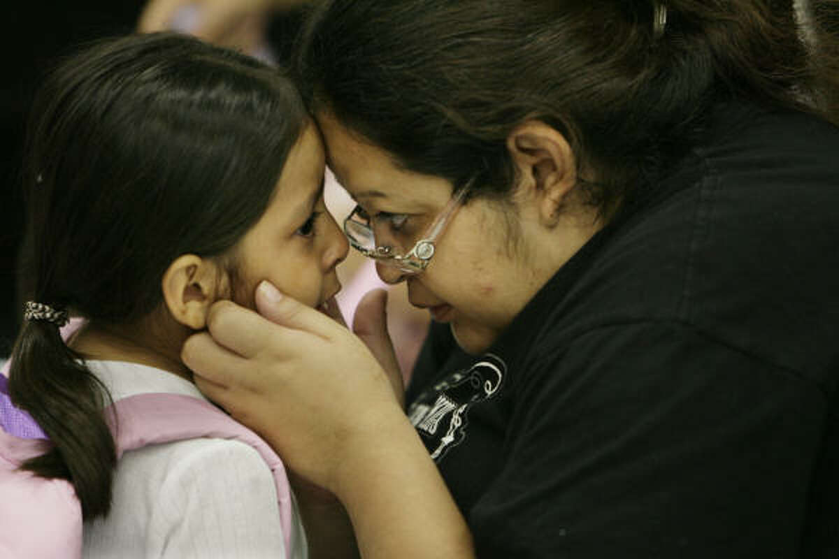 Betty Ruiz comforts her daughter, Ceirra, 5, as school begins at Rosenberg Elementary in Galveston. Ceirra, who attended Scott Elementary before Hurricane Ike, was upset because she was starting at a new school.