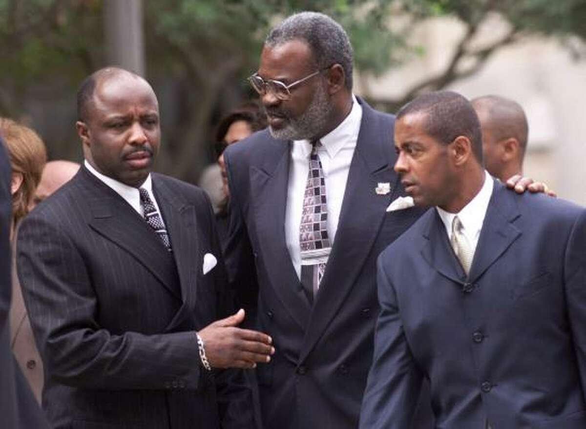 Ron Springs, left — shown with former Cowboys teammates Rayfield Wright and Tony Dorsett at Tom Landry's memorial service in 2000 — has been in a coma since the fall after surgery to remove a cyst. His wife filed a medical malpractice lawsuit.