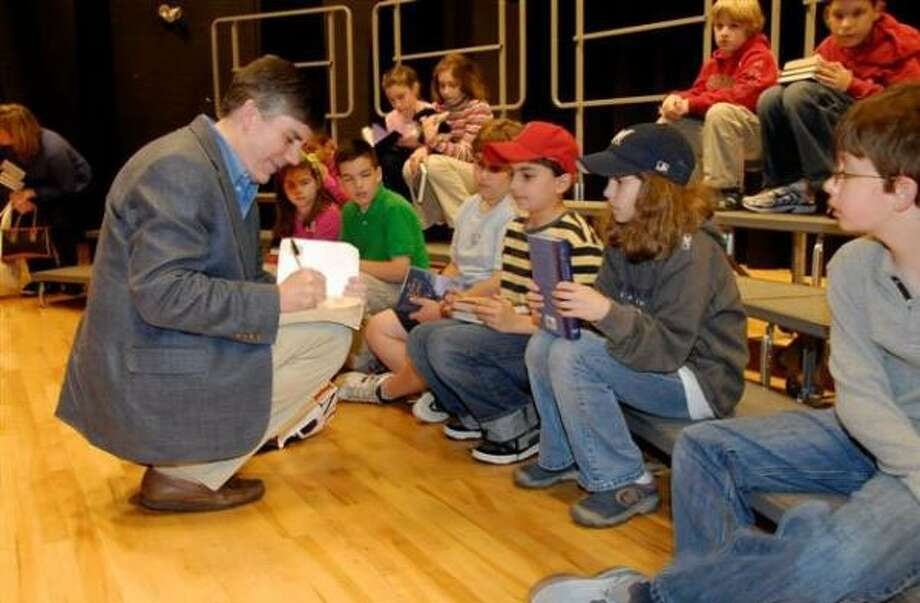 San Antonio novelist Rick Riordan signs books at a Natick, Mass., middle school last year. Photo: WELLESLEY BOOKSMITH