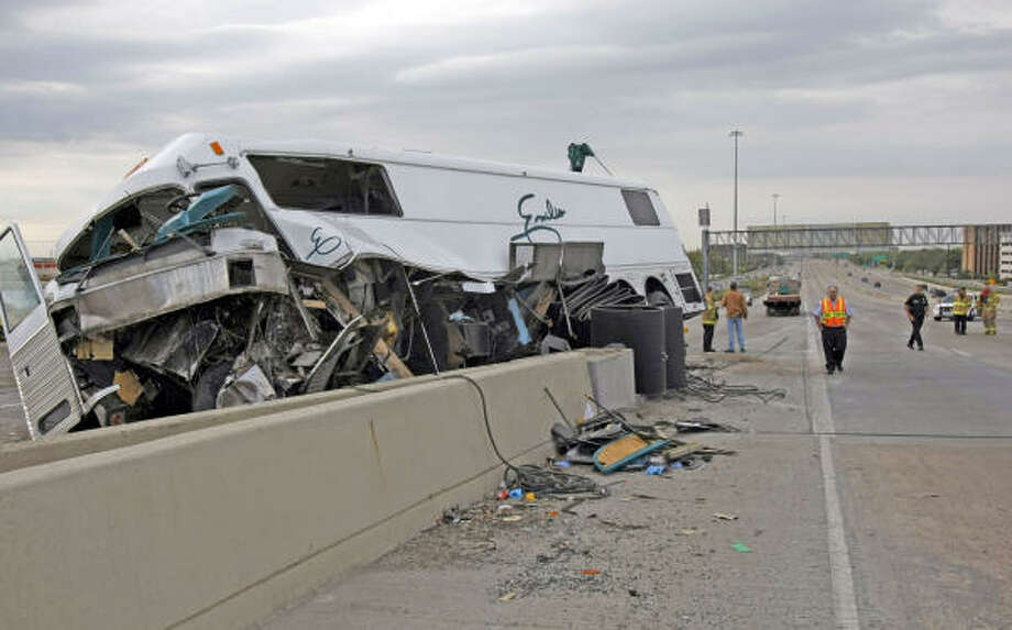 A bus driven by Emilio Navaira slammed into traffic barrels on the northbound West Loop on March 23. Photo: Johnny Hanson, Chronicle