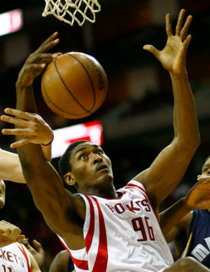 Rockets forward Ron Artest (96) is fouled hard on a put back in the first quarter against the Memphis Grizzlies on Tuesday at the Toyota Center. Photo: Nick De La Torre, Chronicle