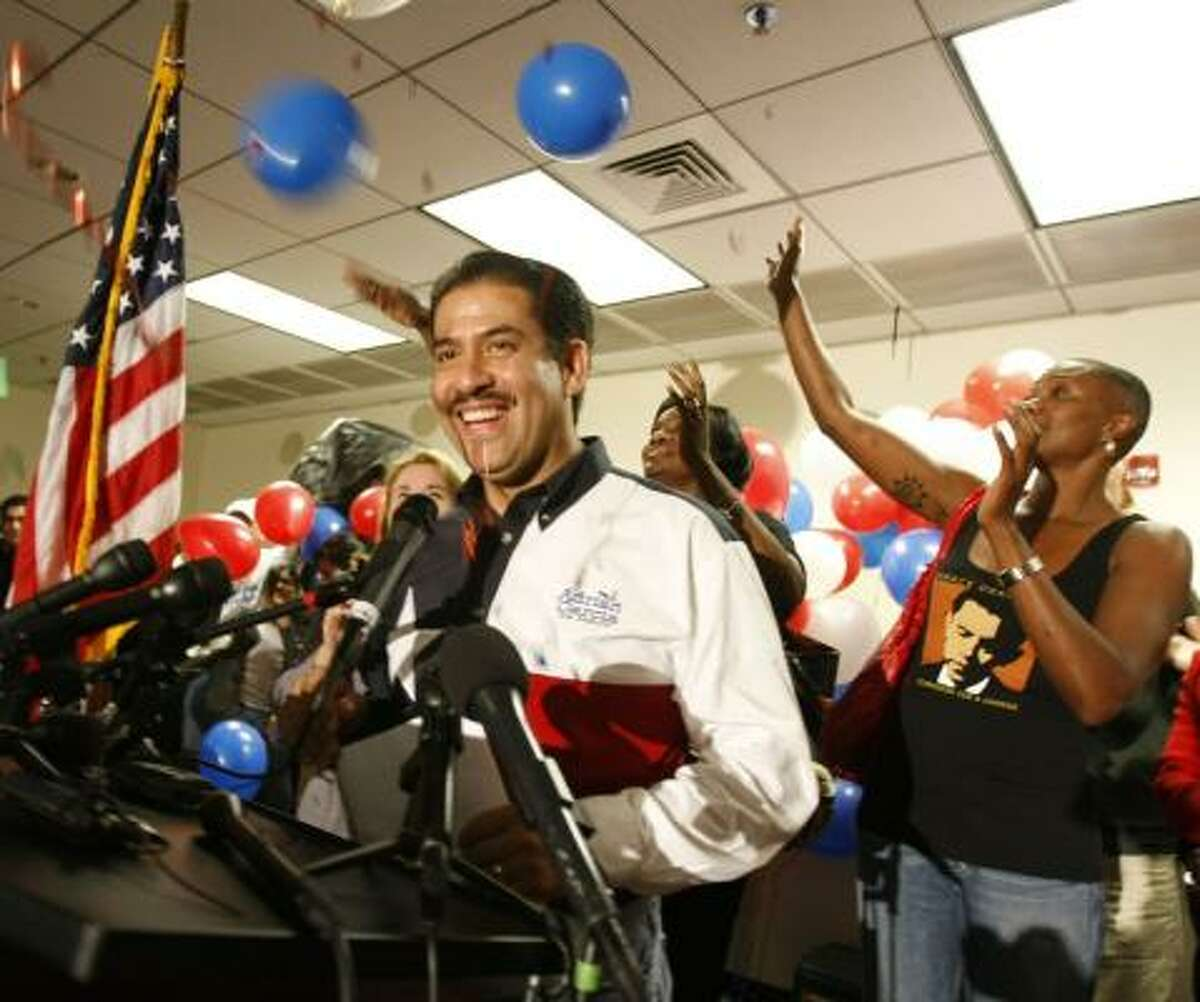 Adrian Garcia addresses supporters at an election night party Tuesday at the Communications Workers of America 6222.
