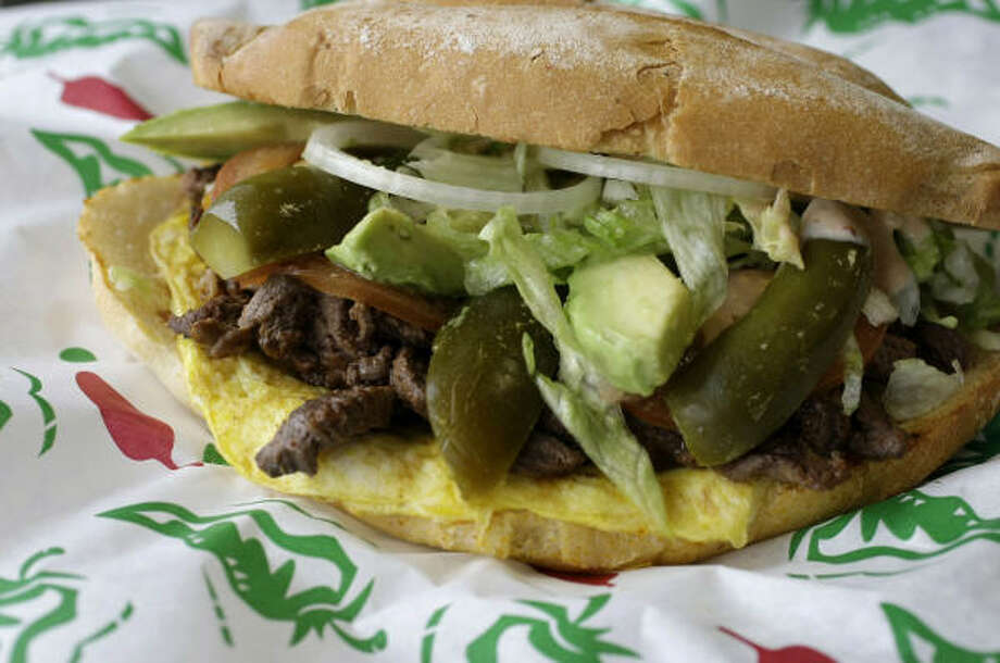 The Nortena torta -- beef fajita strips wrapped in a thin mantle of omelet -- seems to be appropriate for any meal. Photo: Karen Warren, Chronicle