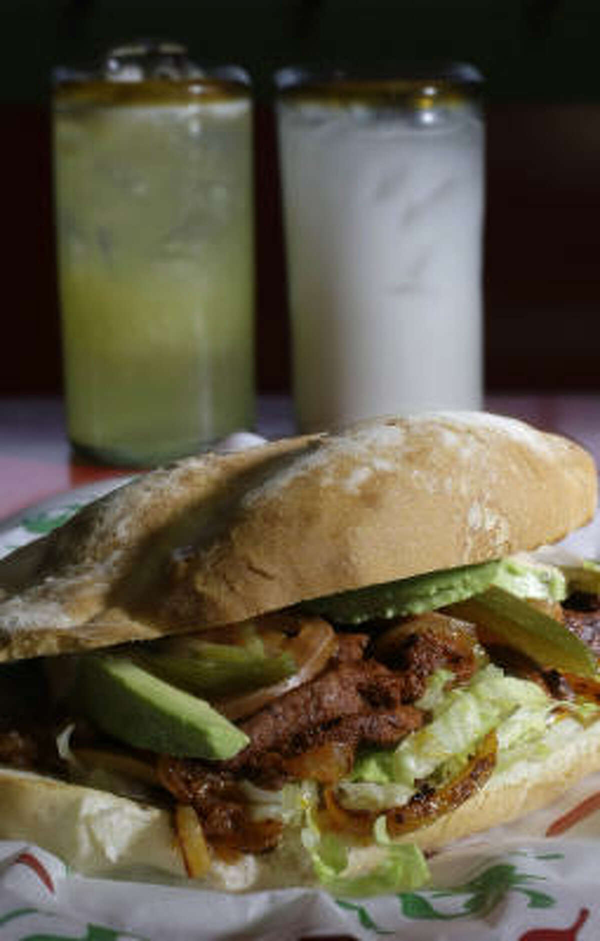 The marinated pork torta (Torta al Pastor) with the Agua de Pena, left, and Agua de Horchata.