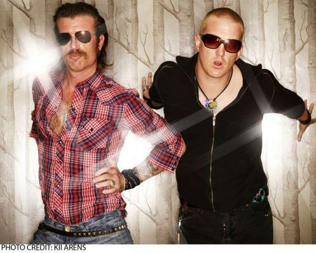 """Jesse """"Boots Electric"""" Hughes, left, and Josh Homme from Eagles of Death Metal."""