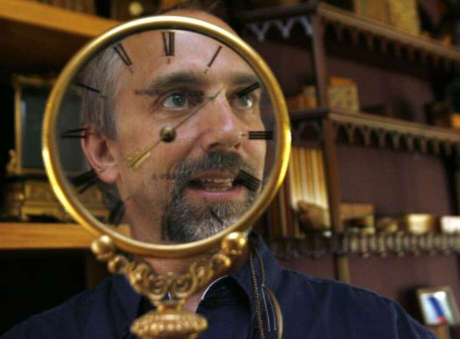 Richard Garriott, at his Austin home with a clock made by magician Jean Eugene Robert-Houdin, will pay $30 million for his trip. Photo: JOHNNY HANSON, CHRONICLE