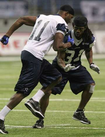Cowboys cornerback Mario Butler (right) goes through drills with Dominique Edison (11) during training camp at the Alamodomeon Tuesday, Aug. 9, 2011. Photo: John Davenport/jdavenport@express-news.net