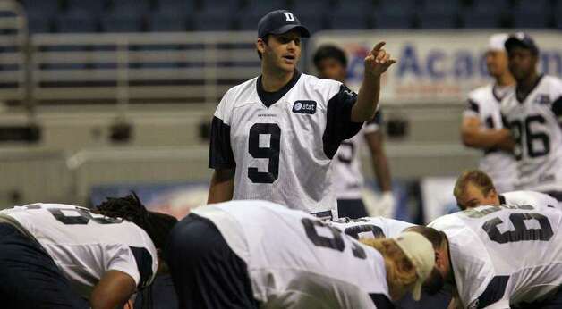 Cowboys quarterback Tony Romo gestures during morning walkthrough at training camp at the Alamodome on Tuesday, Aug. 9, 2011. Photo: John Davenport/jdavenport@express-news.net / SAN ANTONIO EXPRESS-NEWS