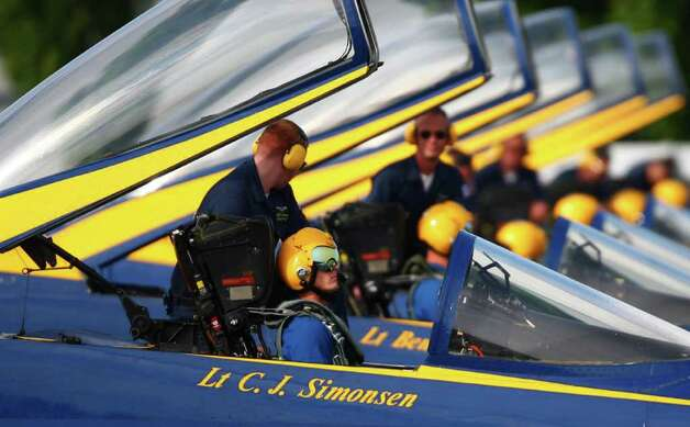 U.S. Blue Angels pilot Lt. C.J. Simonsen is readied in his F/A-18 Hornet on Tuesday, August 9, 2011 at Boeing Field in Seattle. The U.S. Navy flight demonstration team departed their weekend performances during Seattle annual Seafair. Photo: JOSHUA TRUJILLO / seattlepi.com