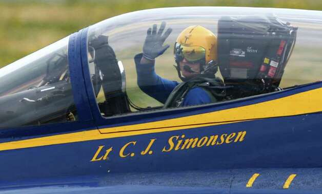 U.S. Navy Blue Angels pilot Lt. C. J. Simonsen waves from the cockpit of his F/A-18 Hornet on Tuesday, August 9, 2011 at Boeing Field in Seattle. The U.S. Navy flight demonstration team departed Seattle after their weekend performances during Seafair. Photo: JOSHUA TRUJILLO / seattlepi.com