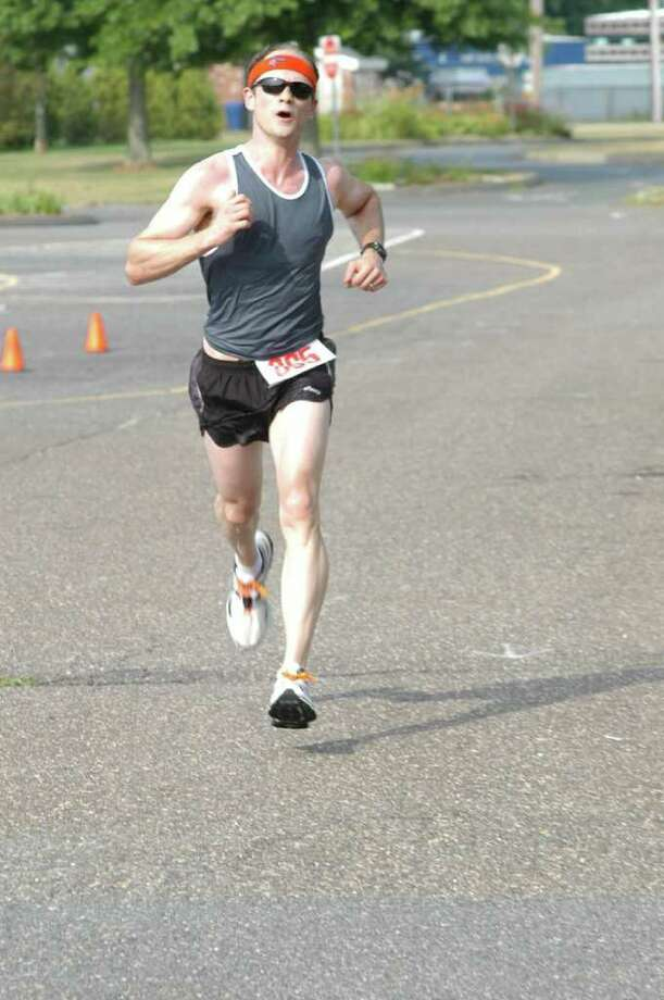 Darien's Peter Bailey finished seventh in the Lightfoot Running Club's 9-mile race which started and finished at Calf Pasture Beach in Norwalk on Saturday. Photo: Contributed Photo