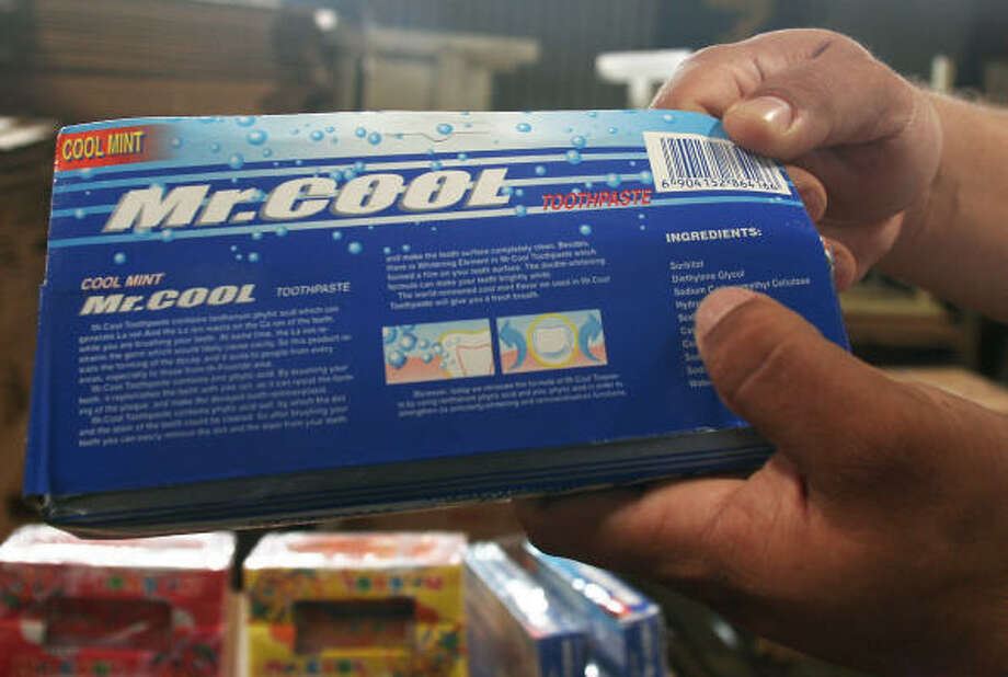 A customs agent illustrates the ingredient diethylene glycol listed on a box of Chinese-made Mr. Cool toothpaste in Managua, on Thursday. Photo: Esteban Felix, AP