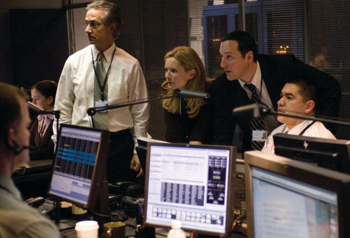 "Government-funded New York City ""Hit Room"" team members--including leader Noah Vosen (David Strathairn), Pamela Landy (Joan Allen) and Cronin (Tom Gallop)--in the espionage thriller The Bourne Ultimatum."