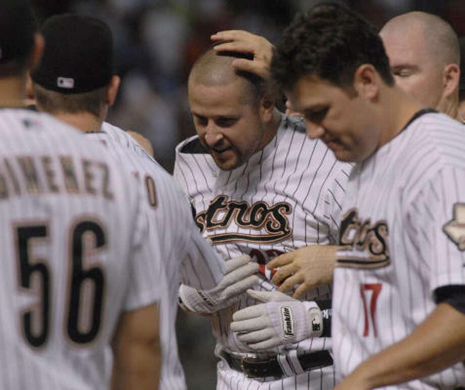Eric Munson is congratulated after his game-winning single on Monday night. Photo: Tim Johnson, Houston Chronicle