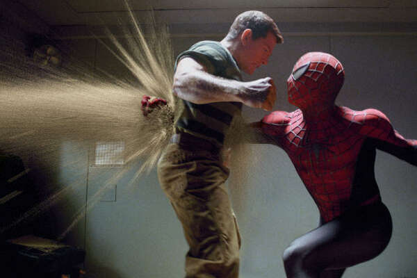 Sandman (Thomas Haden Church) battles Spider-Man (Tobey Maguire), in  Spider-Man 3 .