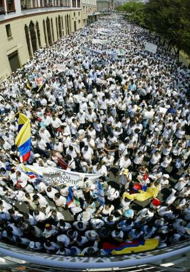 Demonstrators crowd the streets in Cali, Colombia, on Thursday. Similar protests were held in cities across the nation. Some 23,000 Colombians have been kidnapped by guerrillas in the last 11 years. Photo: CARLOS JULIO MARTINEZ, AFP/GETTY IMAGES