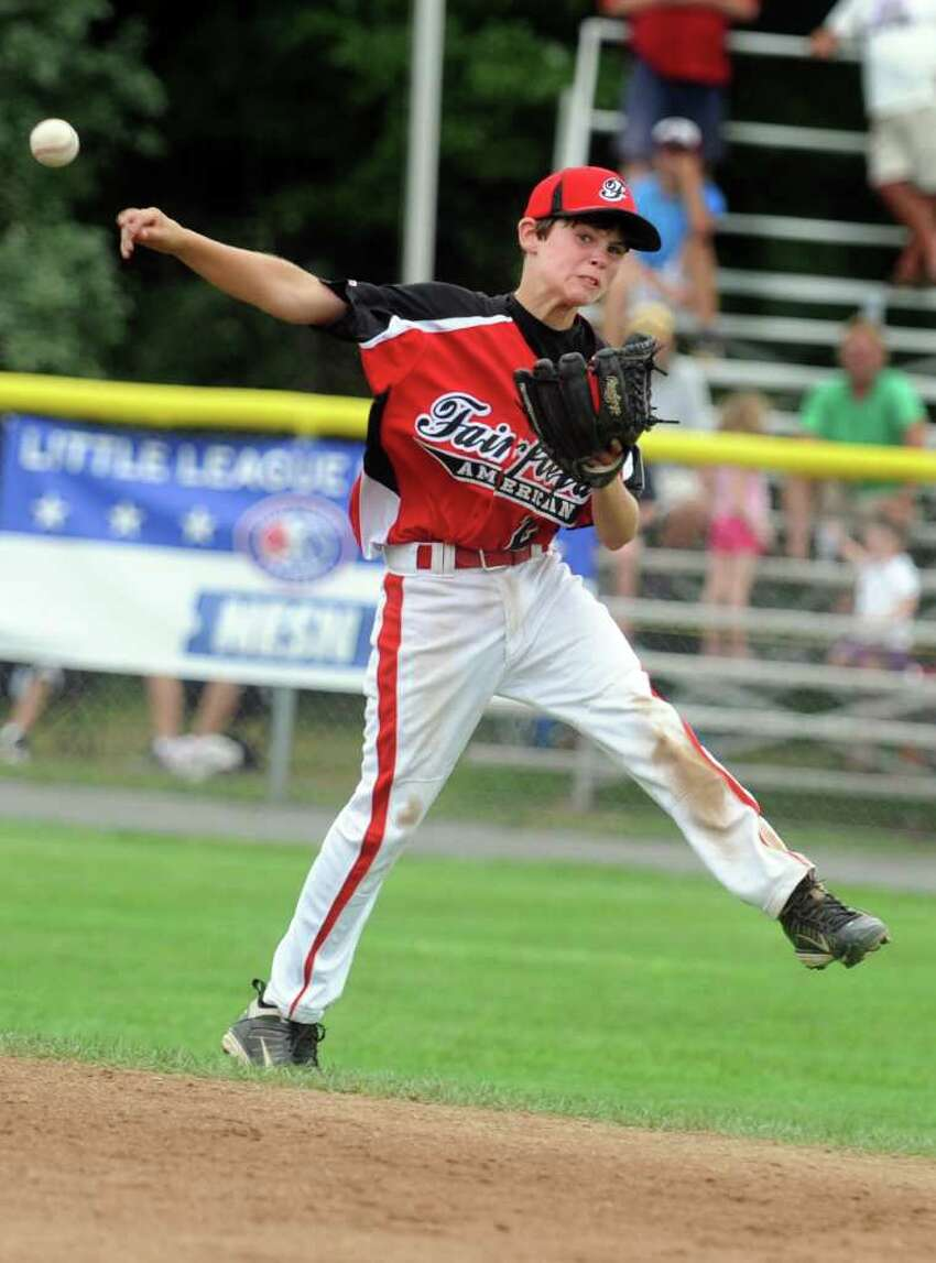 Connecticut's Connor Lynch throws to first base for an out Tuesday, August 9, 2011 during the Little League Baseball Eastern Regional game against Rhode Island at Breen Field in Bristol, Conn.