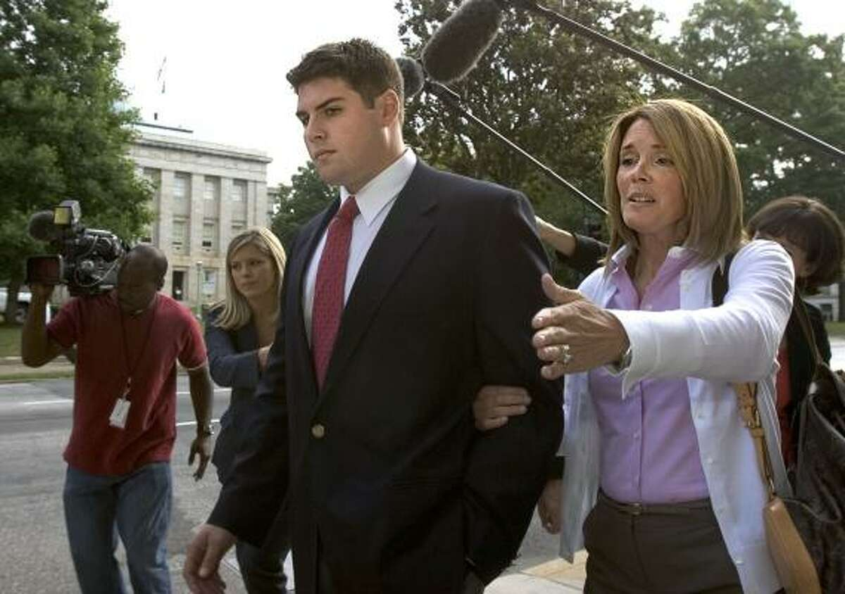 Former Duke lacrosse player Reade Seligmann, escorted by his mother, Kathy, testified Friday at a disciplinary hearing for Durham District Attorney Mike Nifong about the effect of the allegations on his family.