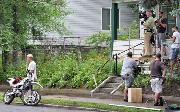 "Ryan Gosling, left, and crew during filming for the movie ""The Place Beyond the Pines"" on Watt Street in Schenectady on Tuesday, Aug. 9, 2011.   (John Carl D'Annibale / Times Union archive) Photo: John Carl D'Annibale / 00014195A"