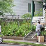 """Ryan Gosling, left, and crew during filming for the movie """"The Place Beyond the Pines"""" on Watt Street in Schenectady on Tuesday, Aug. 9, 2011.   (John Carl D'Annibale / Times Union archive)"""