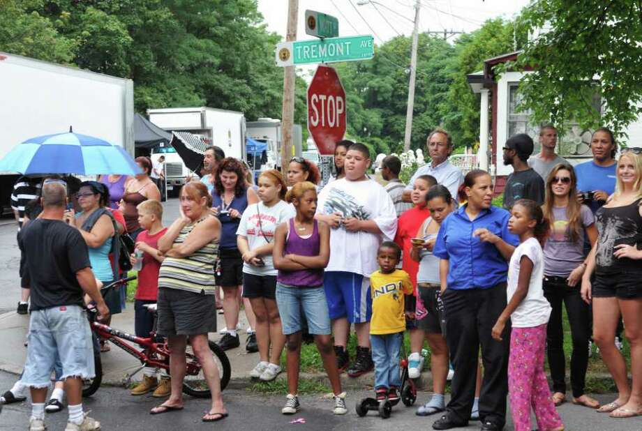 "A crowd gathers to watch filming for the movie ""The Place Beyond the Pines"" on Watt Street in Schenectady Tuesday, Aug. 9, 2011.   (John Carl D'Annibale / Times Union) Photo: John Carl D'Annibale / 00014195A"