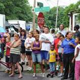 """A crowd gathers to watch filming for the movie """"The Place Beyond the Pines"""" on Watt Street in Schenectady Tuesday, Aug. 9, 2011.   (John Carl D'Annibale / Times Union)"""