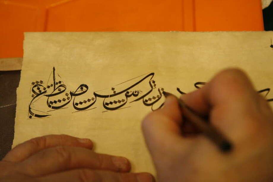 Master calligrapher Mohamed Zakariya demonstrates his craft at the Museum of Fine Arts, Houston. Photo: Melissa Phillip, Chronicle