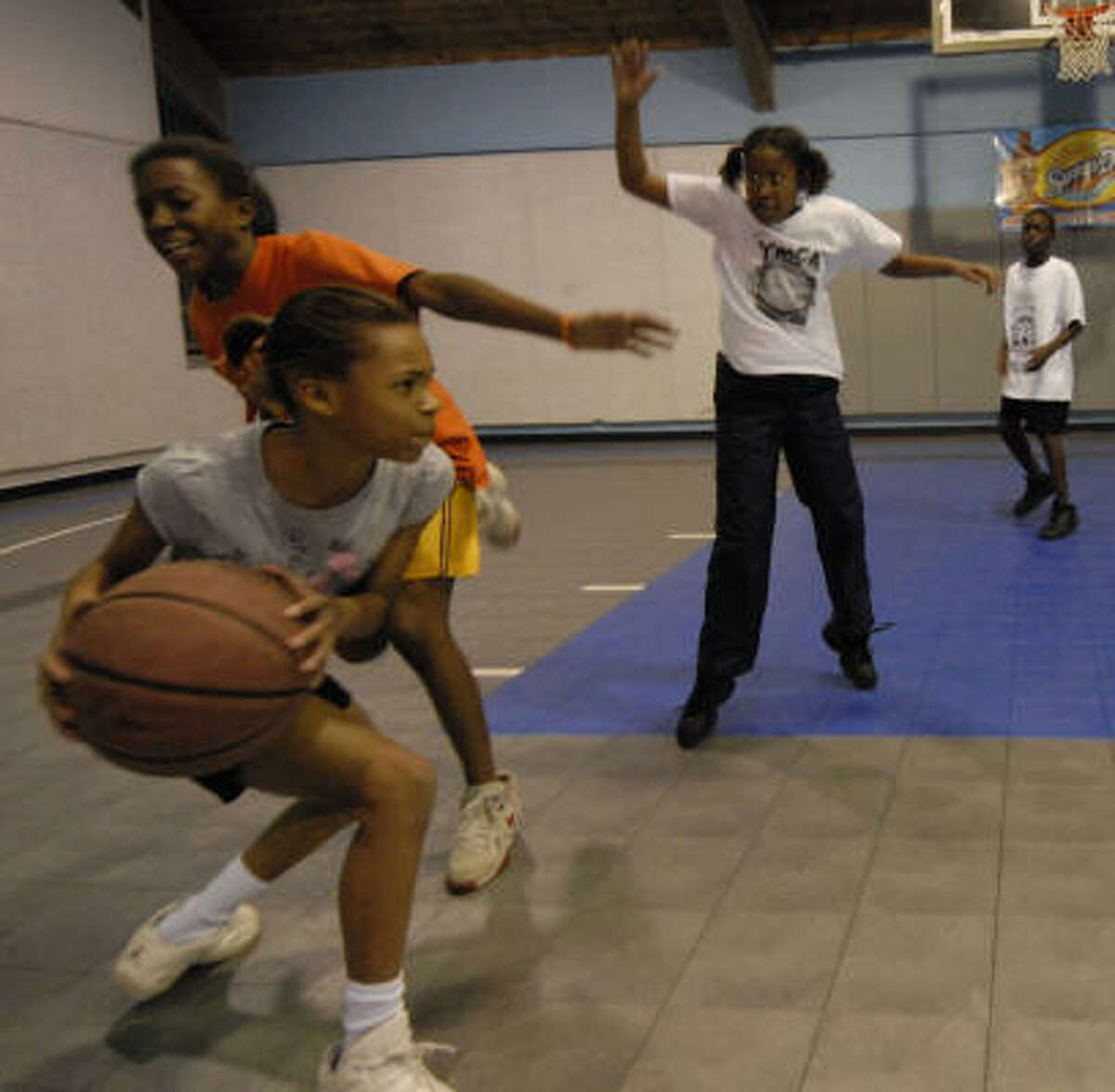 Without a YMCA building, the South Central basketball team practices at a city park gym.