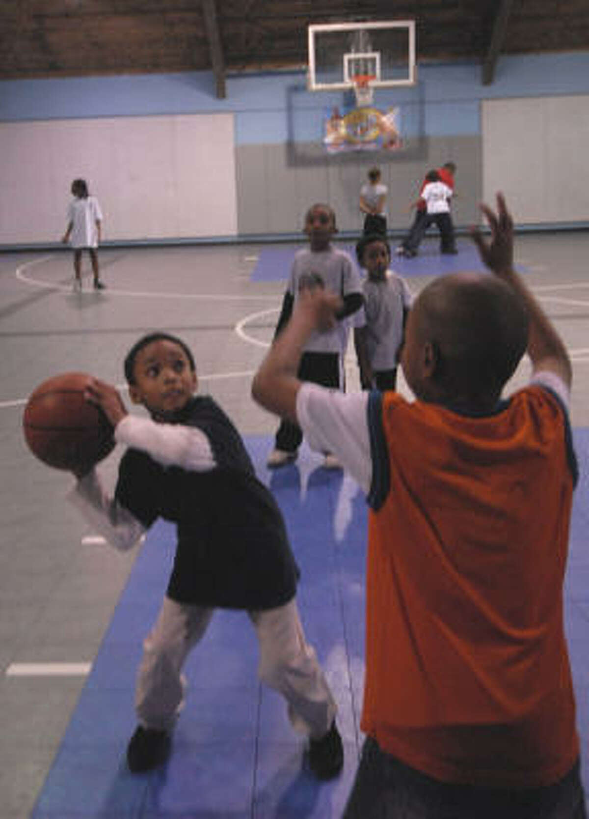 The South Central Y's boys team gets a workout at a city park gym.
