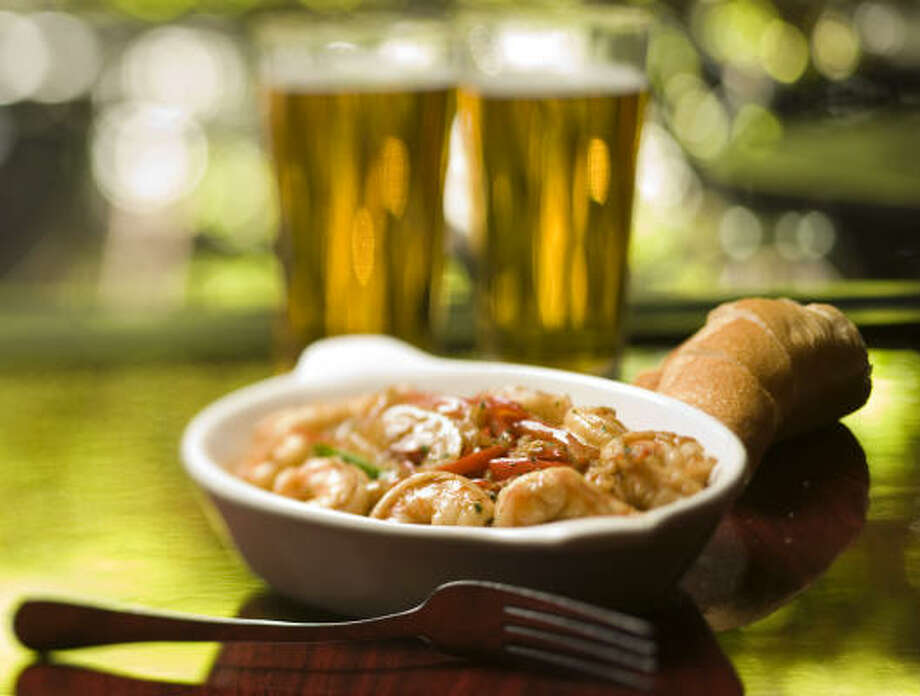 Adding a splash of beer to dishes such as this New Orleans-style Barbecue Shrimp from Bistro Toulouse can punch up the flavor. Photo: SMILEY N. POOL, CHRONICLE