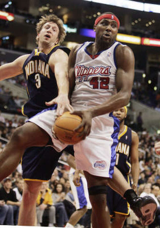 Not wanting to get bumped from the playoffs, Elton Brand (42) and the Clippers are competing with a sense of urgency for the eighth spot in the West. Photo: Reed Saxon, AP