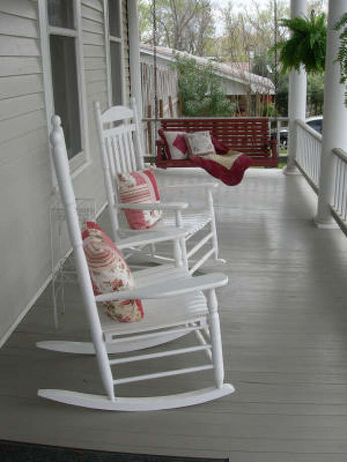 Guests at Palestine's Fig Tree Manor can relax in rocking chairs on a porch. The inn combines overnight accommodations and a restaurant. Photo: Eileen McClelland, Chronicle