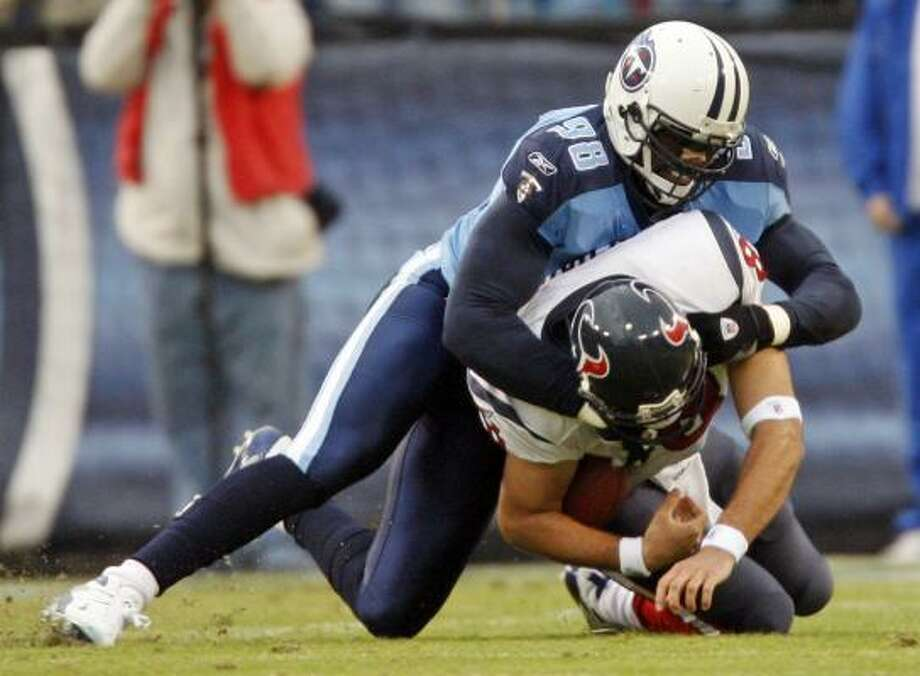 Matt Schaub hits the ground awkwardly on a first-half sack by Antwan Odom. Schaub left the game and did not return. Photo: John Russell, AP