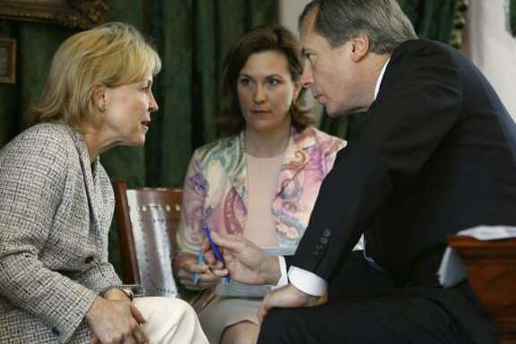 Rep. Myra Crownover, R-Denton, left, talks with Lt. Gov. David Dewhurst in the Texas Senate on Friday. Julia Rathgeber, center, is Dewhurst's director of public policy. Crownover is one of the sponsors of a bill to eliminate smoking in all work and public places.