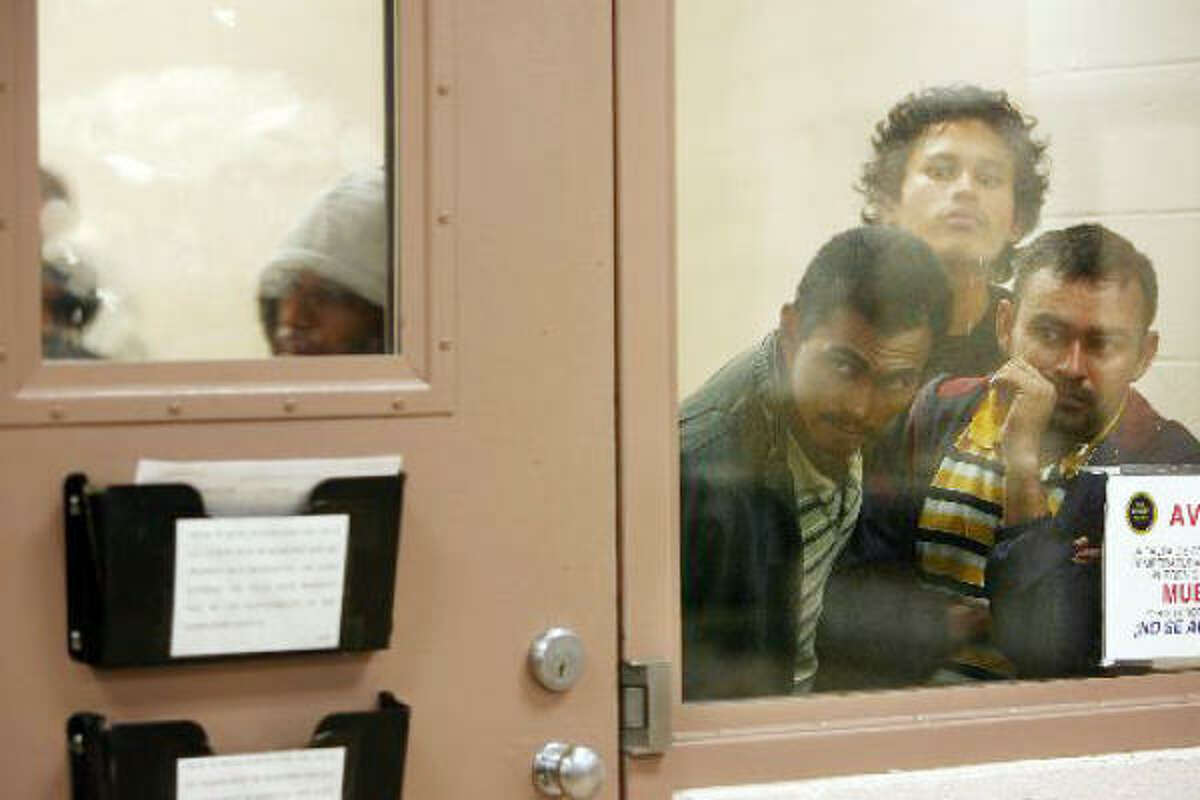 Undocumented immigrants crowd a cell at Border Patrol Station North after hearings at the federal courthouse in Laredo.