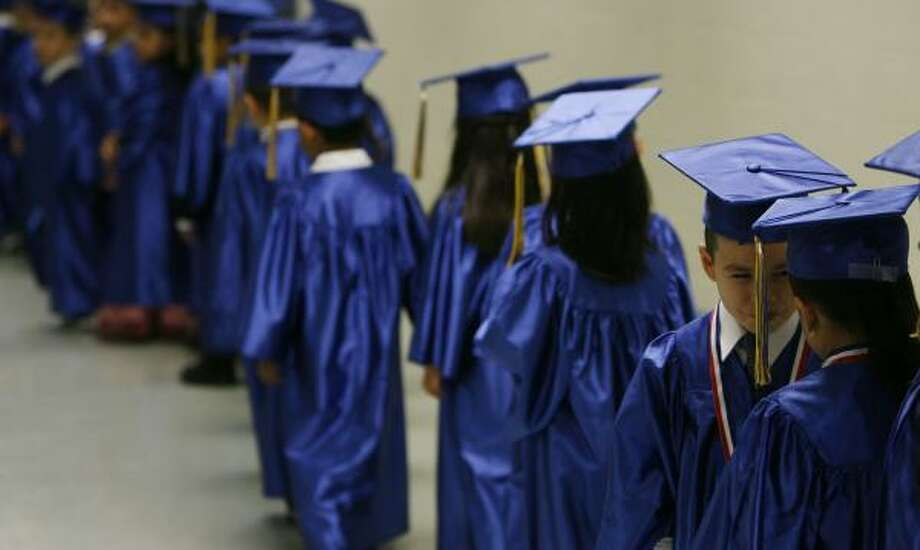 Alex Limon checks out classmate Joana Yanez as their pre-K class in the Aldine school district prepares to graduate. Photo: JAMES NIELSEN, CHRONICLE
