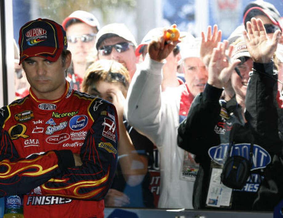 Jeff Gordon and fans watch as Gordon's car is prepared for Sunday's race. Photo: Glenn Smith, AP