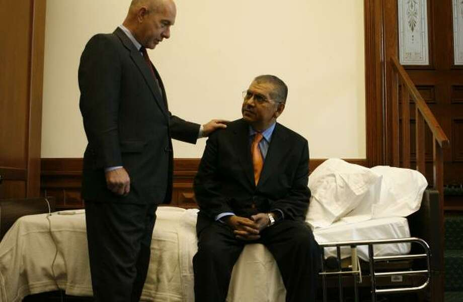 State Sen. Mario Gallegos, right, greets Sen. John Whitmire from his sickbed in the Capitol. Photo: JAMES NIELSEN, CHRONICLE